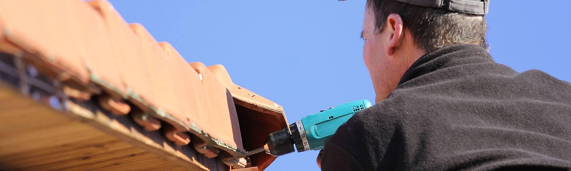 roofer repairing a roofline