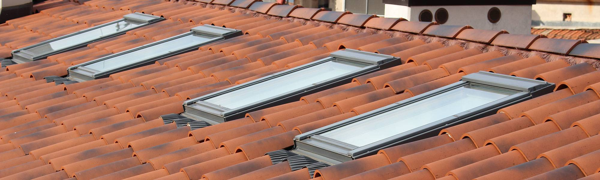 velux windows in a clay tiled roof