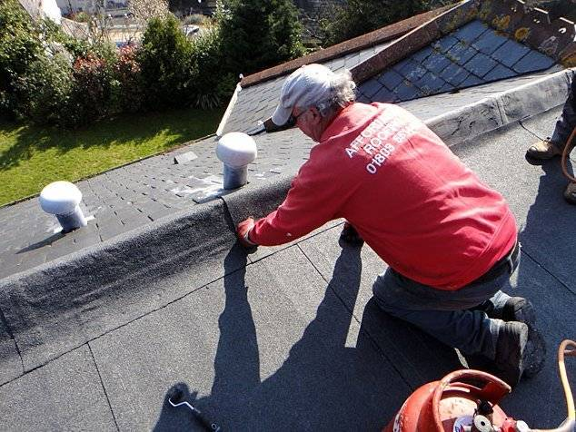 roofer repairing a flat roof