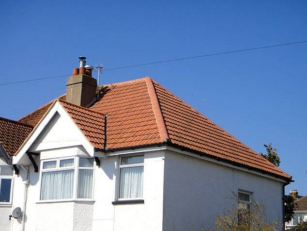 traditional semi detached house with tiles roof