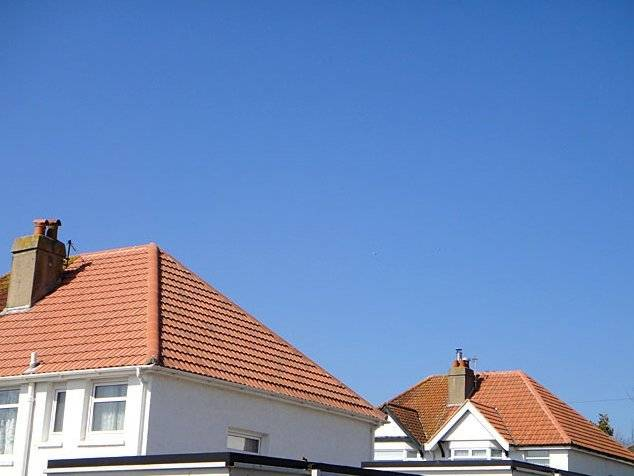 traditional semi detached homes with tiles roofs