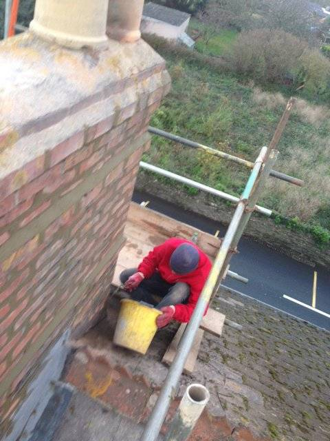 roofer repairing a chimney
