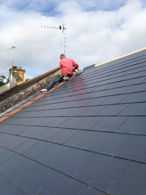 roofer reslating a pitched roof