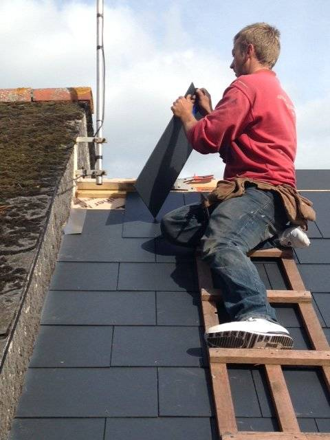 roofer reslating a roof
