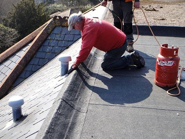 roofer repairing a roof