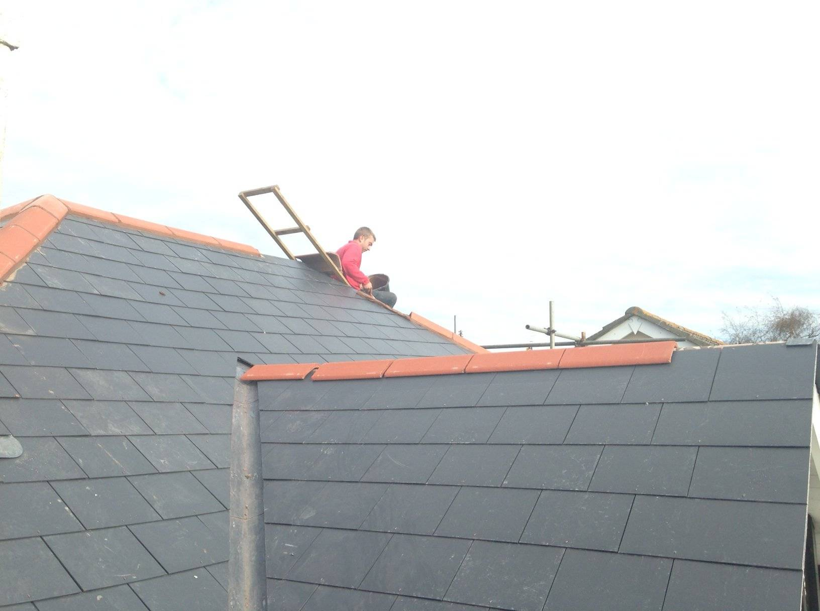 roofer working on a pitched slate roof