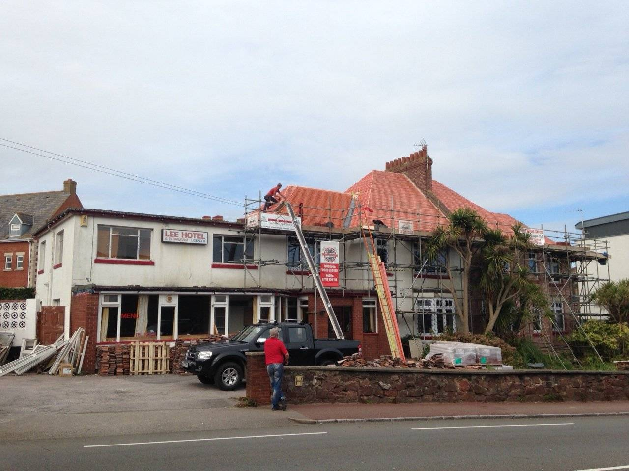 replacement roof being performed on a semi detached home