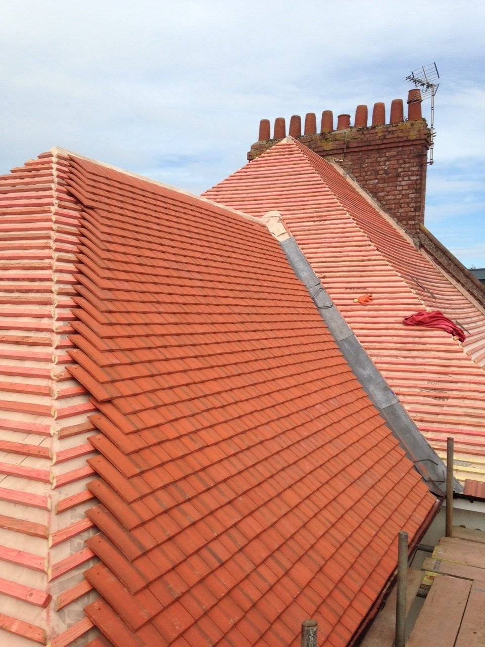 retiling a roof with clay roof tiles