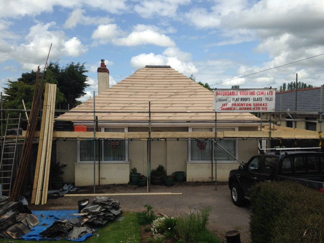 reroofing a bungalow with visible roof battons
