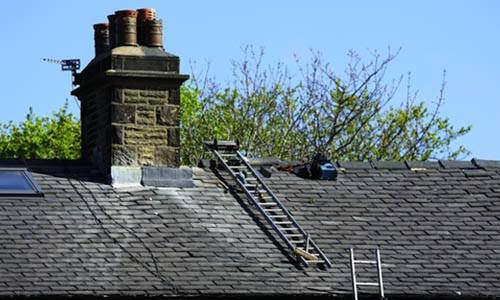 roof-maintenance-navigation-box-image-slate-roof-and-chimney-awaiting-repair